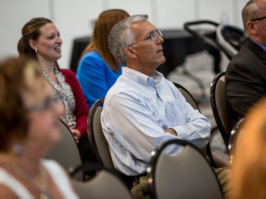 Hale Walker, co-founder of Michigan Mutual, listens as a team of students does a presentation on improvements the company can make to their culture team during Challenge 4 the Future Tuesday, July 12, 2016 at the Blue Water Area Convention Center. The competition, sponsored by St. Clair County RESA, paired area high school students with local organizations to help solve real-world challenges the organizations face.