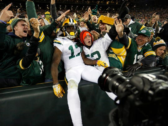 Green Bay Packers receiver Davante Adams celebrates a touchdown with fans during the second half of an NFL football game against the Chicago Bears, Thursday, Oct. 20, 2016, in Green Bay, Wis.