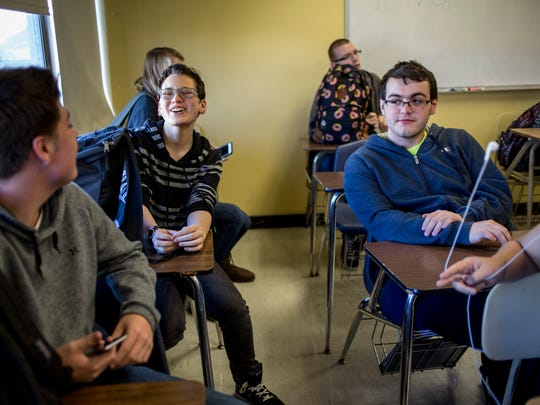 Dominick Newsome, 17, laughs while chatting with Caden Barrett and Ethan Kane, both 16, during a world history class last October at Port Huron Northern High School.