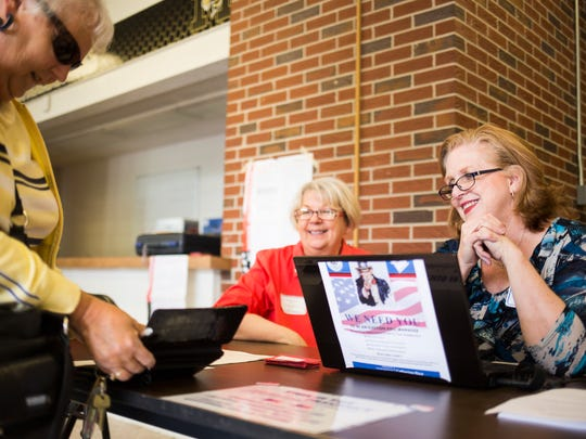 Poll manager Jill Burroughs, right, greets voters and takes their information at McCants Middle School in Anderson during Tuesday's Republican runoff for the South Carolina Senate District 3 seat.
