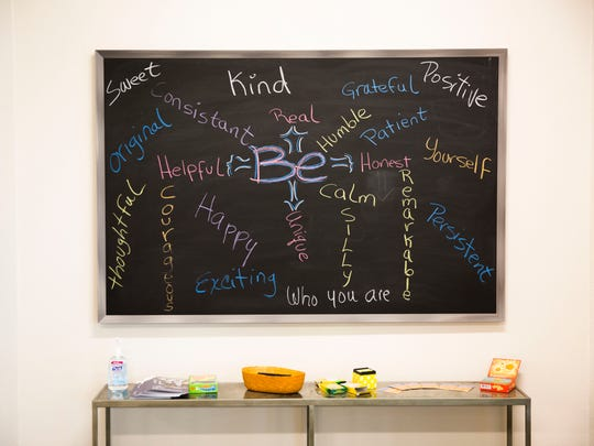 A chalkboard covered in kind words greets the teens