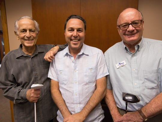 "Mark Medoff, Ross Marks, and Joe Bullock paid a visit to First America Bank in July. 90 percent of the financing for ""Walking With Herb"" is from local investors."