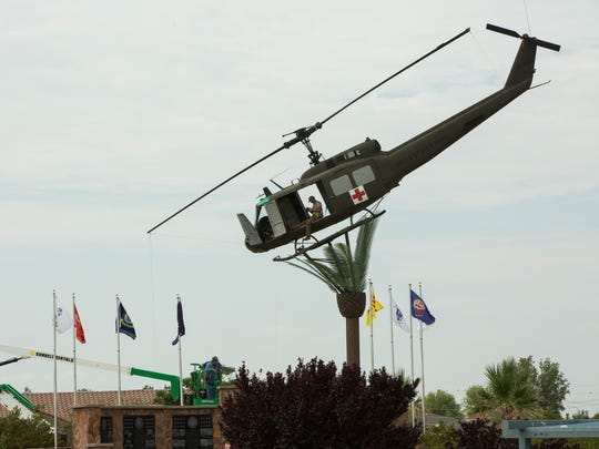 George W. Hayduke takes a few photographs from the inside of the Bell UH-1 Iroquois helicopter at Veterans Memorial Park, Friday July 27, 2018.