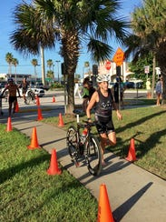 Women's winner Robin Sandos at the bike-run transition