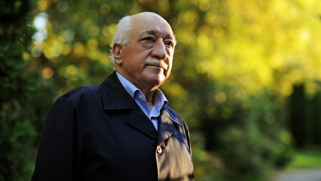 FILE - In this Sept. 24, 2013 file photo, Turkish Islamic preacher Fethullah Gulen is pictured at his residence in Saylorsburg, Pennsylvania, United States. Police conducted raids in a dozen Turkish cities Sunday, detaining at least 24 people — including journalists, TV producers and police — known to be close to a movement led by a U.S.-based moderate Islamic cleric who is a strong critic of President Recep Tayyip Erdogan. It was the latest crackdown on cleric Fethullah Gulen's movement, which the government has accused of orchestrating an alleged plot to try to bring it down.