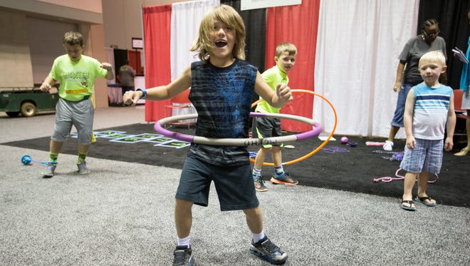 Hyatt Watson, 7, does a Hula Hoop, as he and his three brothers, all of Fairland, play at Indiana Black Expo, Summer Celebration, at the Indiana Convention Center, Indianapolis, Friday, July 15, 2016.