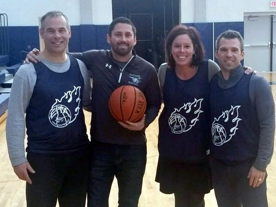 East Irondequoit teachers Paul Stack, Dan Roser, Catherine Carroll-Edwards and John Edwards will be joining more than a dozen other colleagues on the court for the East Irondequoit Teachers' Association vs. Irondequoit Police Department benefit basketball game on Friday February 3. All proceeds from the game will benefit the Irondequoit Community Cupboard.