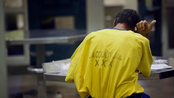 An inmate with mental health conditions is handcuffed to a table while jailed in the Medium Observation Housing at the Los Angeles County Sheriffs Department Twin Towers Correctional Facility in Los Angeles, California, U.S., on Tuesday, Sept. 23, 2014. Conditions for mentally ill inmates in Los Angeles county have been a focus of federal probes since 1997, and the number with psychiatric disorders was an issue in a recent debate over a new jail. Photographer: Patrick T. Fallon/Bloomberg via Getty Images