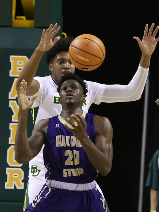 Alcorn State forward Yalen Reed (20) loses the ball as he is guarded by Baylor forward Terry Maston (31) in the second half of an NCAA college basketball game, Friday, Nov. 17, 2017, in Waco, Texas. (Jerry Larson/Waco Tribune Herald, via AP)
