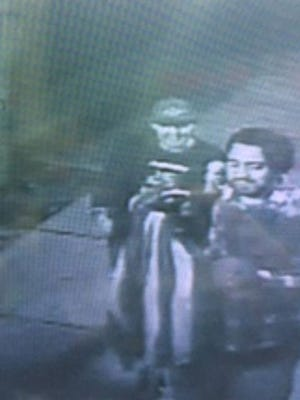 Police say the person on the right in this surveillance photo stole a flag from Express Food Market in Gloucester City.