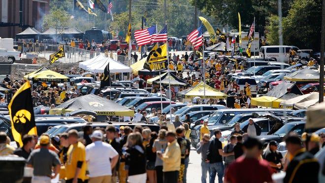 Fans tailgate outside of Kinnick Stadium in Iowa City.