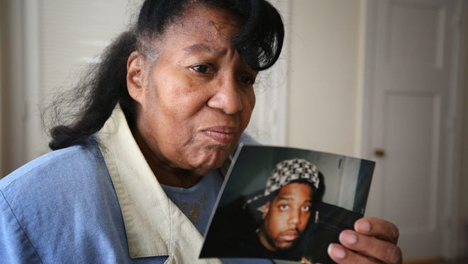 Lorraine Roper holds a photo of her son Andrew Key Roper, who was shot and killed in 2015. February 3, 2016