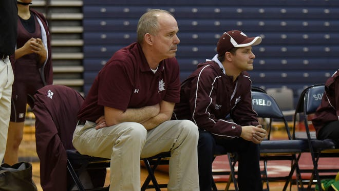 Head coach Neil Tuomi (left) led Birmingham Seaholm to its sixth team district title in his eight years as head coach Wednesday evening.