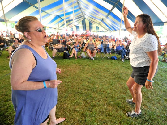 Patrons dance to the music of Jimmi and the Band of Souls during the 2015 Big Bull Falls Blues Fest at Fern Island in Wausau.