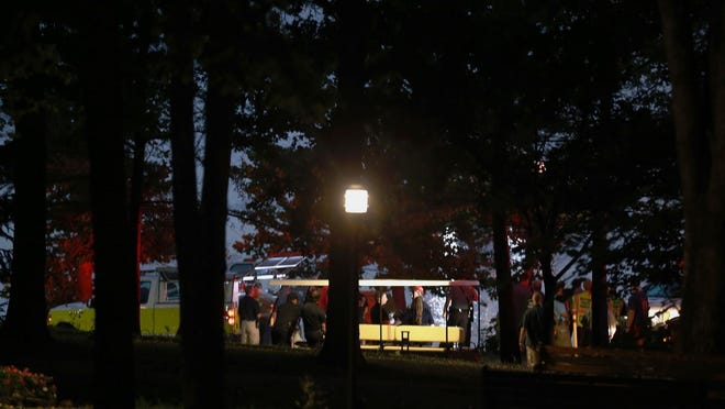 Emergency responders work at Table Rock Lake after a deadly boat accident in Branson, Mo., Thursday, July 19, 2018. A sheriff in Missouri said a tourist boat has apparently capsized on the lake, leaving several people dead and several others hospitalized. (Nathan Papes/The Springfield News-Leader via AP)