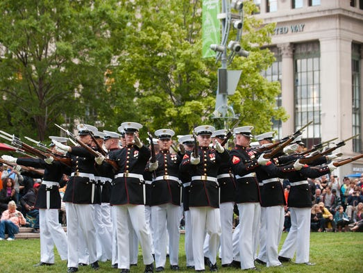 The Marine Corps Silent Drill Platoon entertains the