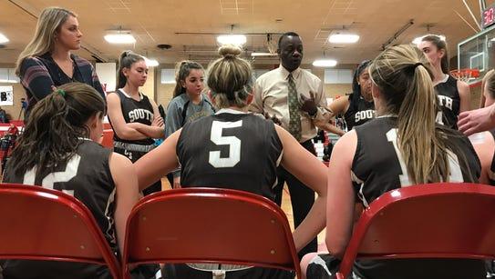 Clarkstown South head coach Larry Milligan talks to
