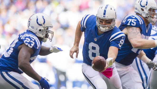 Indianapolis Colts quarterback Matt Hasselbeck (8) drops back to hand off the ball to running back Frank Gore (23) during first half action of an NFL football game at Lucas Oil Sunday, Oct. 4, 2015.