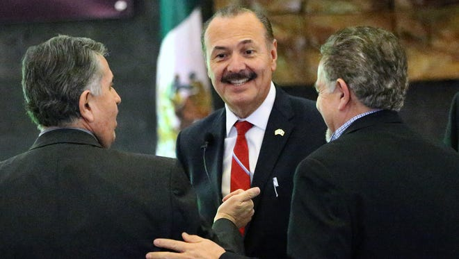 Marcos Bucio, center, consul general of Mexico in El Paso, greets people who attended his address on U.S.-Mexico relations Thursday at the Mexican Consulate in Downtown El Paso.