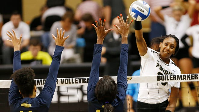 Danielle Cuttino of Purdue tries to spike the ball past Tayaln Nero, left, and Bri Greenlee of Oral Roberts Friday, August 25, 2017, at Holloway Gymnasium on the campus of Purdue University. Purdue defeated Oral Roberts 25-15, 25-13, 25-20.
