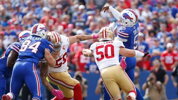 Buffalo Bills quarterback Tyrod Taylor (5) is hit by