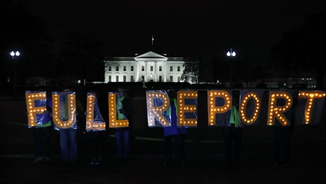 """Members of the protest group Herndon Reston Indivisible and Kremlin Annex hold signs saying """"Full Report,"""" outside the White House in Washington, Monday, March 25, 2019, as they protested for the complete results to be released of special counsel Robert Mueller's investigation into Russian election interference and possible coordination with associates of President Donald Trump."""