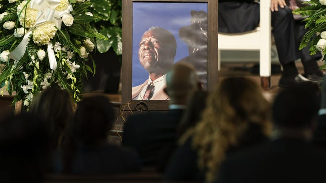 """A photograph of Henry """"Hank"""" Aaron, longtime Atlanta Braves player and Hall of Famer, sits outside his casket during his funeral on Wednesday, Jan. 27, 2021 at Friendship Baptist Church in Atlanta."""