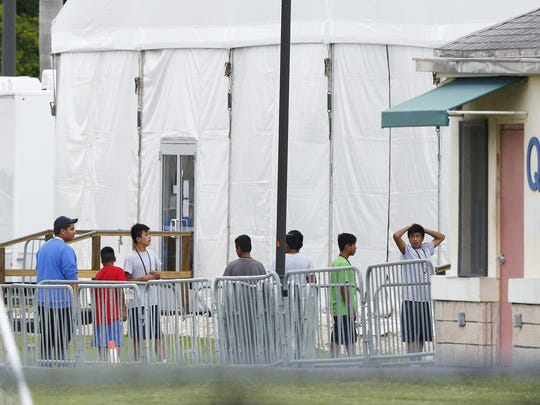 The Justice Department said in a court filing late Friday that it will take at least a year to review about 47,000 cases of unaccompanied children taken into government custody between July 1, 2017 and June 25, 2018.