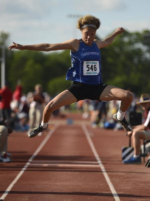 Green Bay Southwest's Natisha Hiedeman leaps in the Division 1 triple jump during the WIAA state track and field meet.