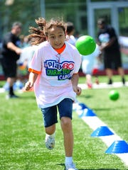 Heidi Rivera, 10, of Morristown, runs one of the fitness