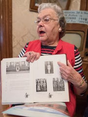 """Frances Miller holds her Waynesboro High School yearbook while pointing to a photo of herself when she was the head majorette in band; Miller was at a group chat at the Waynesboro Historic Society in Waynesboro, Pa. on Saturday, March 13, 2016. The main focus of the group chat wa, """"A teenager through the years,"""" Miller is from the graduating class of 1947."""
