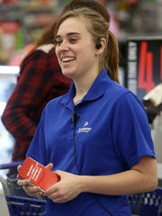 Katie Radcliff smiles as she jokes around with a customer on Black Friday at Academy Sports + Outdoors in Jackson, Tenn., on Nov. 25, 2016.