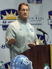 North Carolina Tar Heels defensive coordinator Gene Chizik talks about his teams matchup against the Stanford Cardinal in this Friday's 83rd Annual Hyundai Sun Bowl game during a press conference Wednesday at Hawthorn Suites.