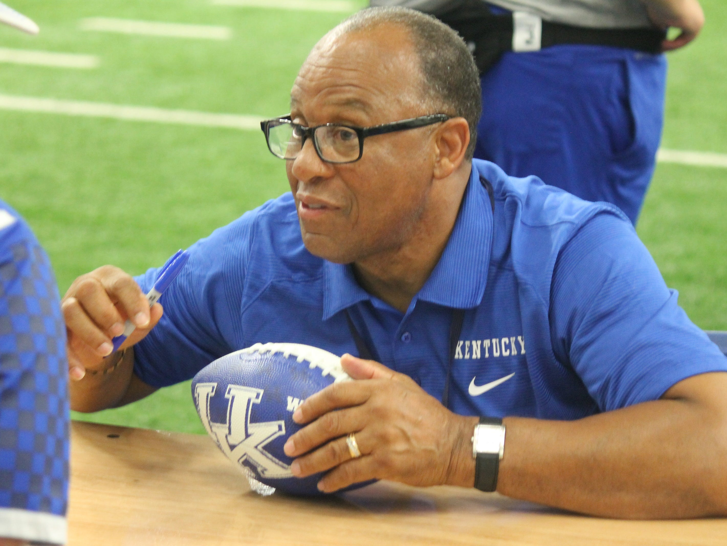Former UK football player Wilbur Hackett, the first African American team captain in the SEC, signed autographs as part of UK's 2016 fan day festivities.