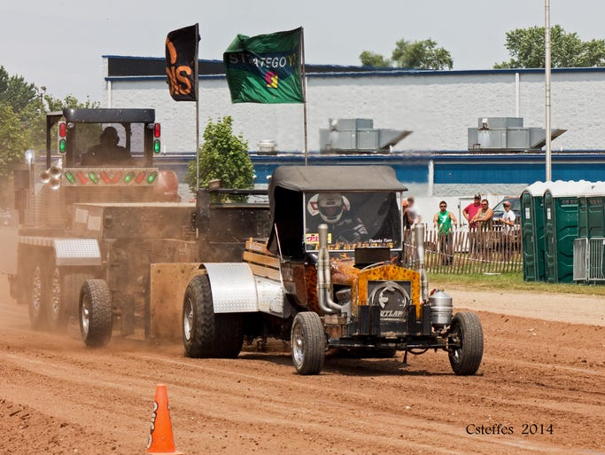 A truck pulls a sled during the tractor pull at the Fond du Lac County Fair.