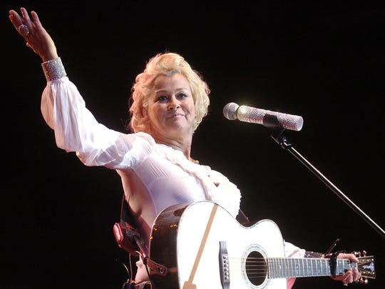 Country star Lorrie Morgan gestures to the crowd at the Montana State Fair in 2011.