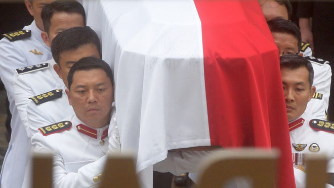 Pallbearers carry the coffin of Singapore's late leader Lee Kuan Yew at his state funeral at the University Cultural Center.
