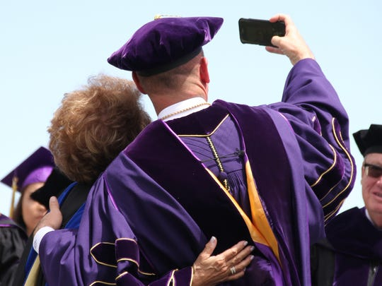 Western New Mexico University President Dr. Joseph Shepard and Dr. Antonia Coello Novello paused during the commencement ceremony for a selfie.