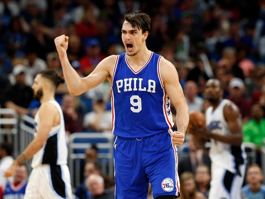 Philadelphia 76ers forward Dario Saric (9) reacts after