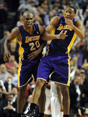 Wesley Johnson (11) celebrates his go-ahead bucket with Jodie Meeks (20).
