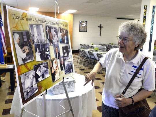 A poster inside St. Gregory School in St. Nazianz on Saturday, Aug. 22, shows pictures of the Salvatorian Sisters' history in the village. The school was the site of a potluck dinner for the sisters in honor of their 119-year presence in the village that will be ending on Monday, Aug. 31.