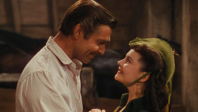 "This photo provided by Warner Bros. Home Entertainment shows Clark Gable as Rhett Butler, and Vivien Leigh as Scarlett O'Hara in a scene from the film, ""Gone With the Wind."" The film's 75th anniversary will be celebrated over the next week, with special screenings and Warner Bros. Home Entertainment's release of a lavish new limited-edition box set."