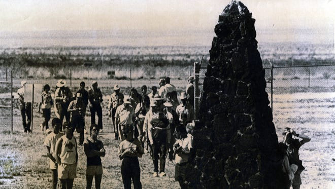 Crowds gather around a monument marking ground zero of the first atomic explosion in the White Sands Missile Range in New Mexico on July 16, 1945. The site, known as Trinity Site, is opened to the public twice a year.