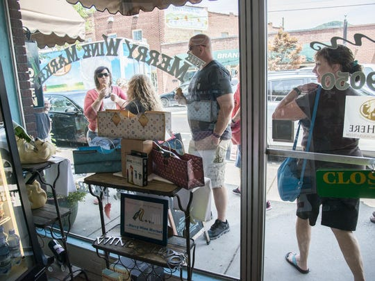 Saturdays are especially busy during the summer at Merry Wine Market, as are Black Mountain's sidewalks.