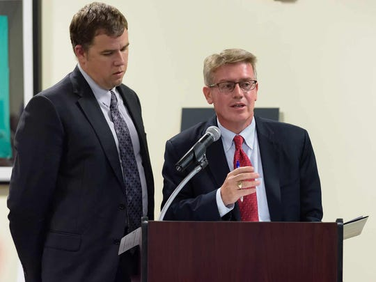 Steven Lewandowski of Cabe Associates (left) and Attorney Mark Dunkle Attorney present a data center-power plant development and land use proposal at Middletown Town Hall on monday night.