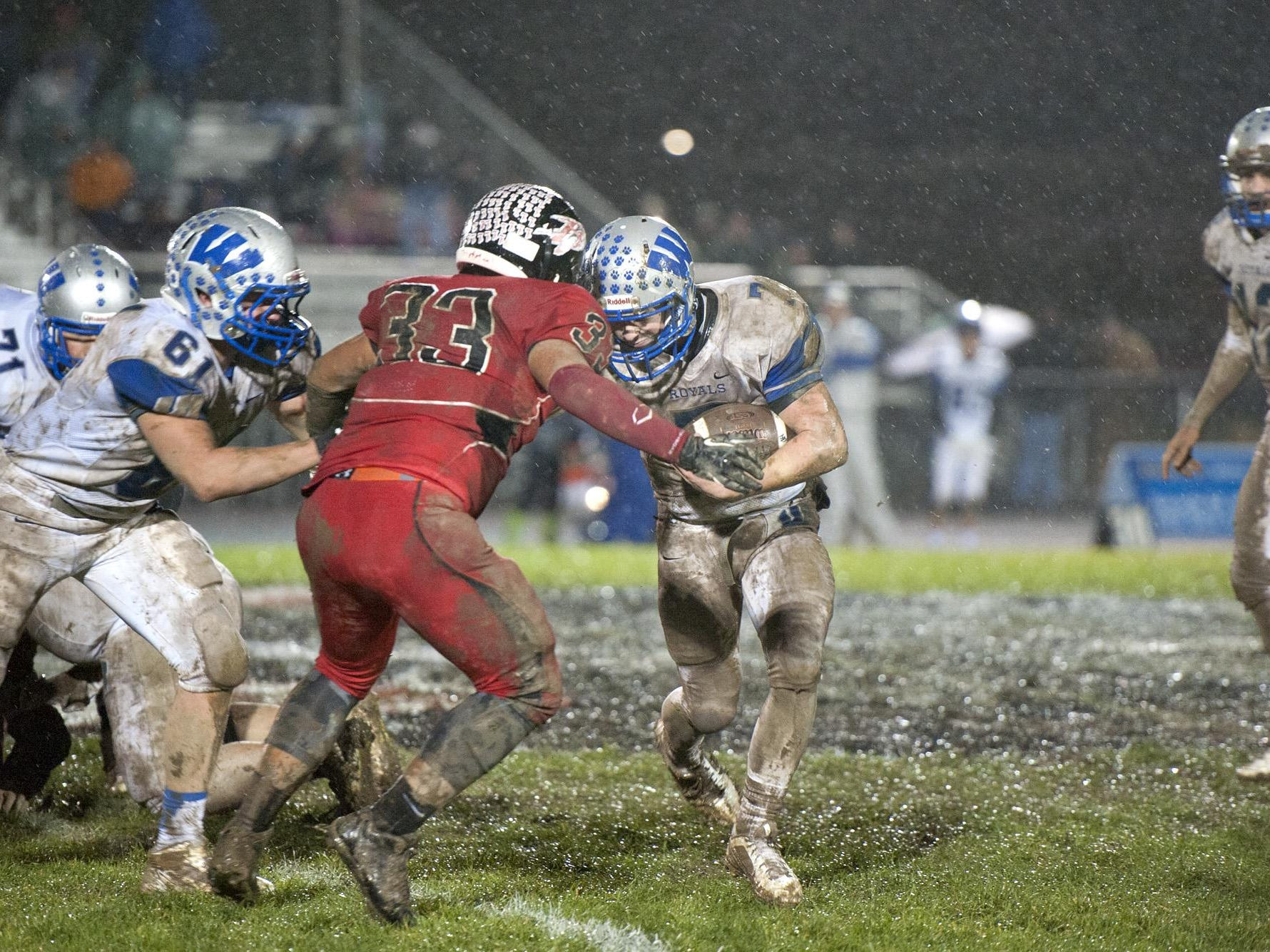 Mike Dornbirer/Gannett OhioWynford's Nick Looker runs the ball against Bucyrus during the annual Copper Kettle game Oct. 31.