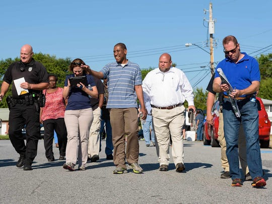 City, neighborhood and faith leaders take a neighborhood walk down Lincoln Street in Dover on Saturday. It wasd part of a tour through Simon Circle and Lincoln Park neighborhoods in West Dover to focus more attention on crime and other problems in those communities.