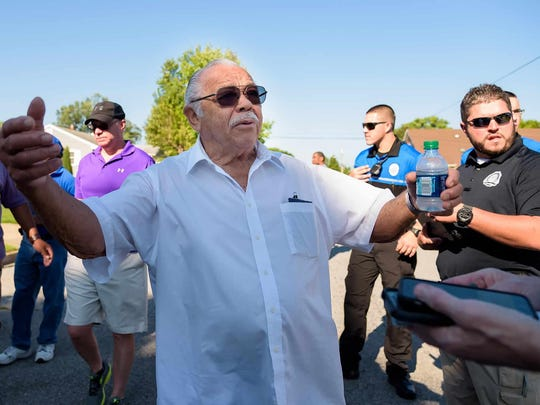 Charles Durham of Dover voices his concerns to city, neighborhood and faith leaders walking through troubled Simon Circle and Lincoln Park neighborhoods in West Dover on Saturday morning.