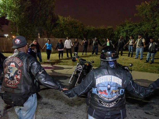 Bishop Billy J. Lane Jr. leads the group in prayer before starting their ride. Night Peace Ride starting at the WaWa at 4000 N. Dupont Hwy in New Castle and stopping at various locations around Wilmington where there have been shootings. Keesa Anderson, founder of peace group Sweep the Streets. Sweep the Streets was established in honor of Anderson's son Jermaine Goins Jr., who was killed Sunday, August 4th, 2013 in a Wilmington shooting. DOUG CURRAN/SPECIAL TO THE NEWS JOURNAL
