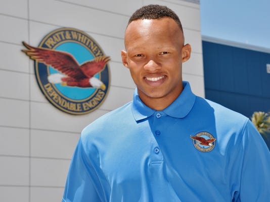 In this May 27, 2015 photo provided by Pratt & Whitney, Tennessee quarterback Joshua Dobbs is shown at the Pratt & Whitney facility in West Palm Beach, Fla. Dobbs traveled to the facility in May to work an internship testing aircraft engines at Pratt & Whitney's West Palm Beach branch. Dobbs says the experience offered lessons he could carry over to football. (Pratt & Whitney via AP)